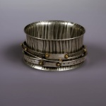 Wide Bangle with Spinners by Connie Fox. Jewelry photography by Steve Rossman