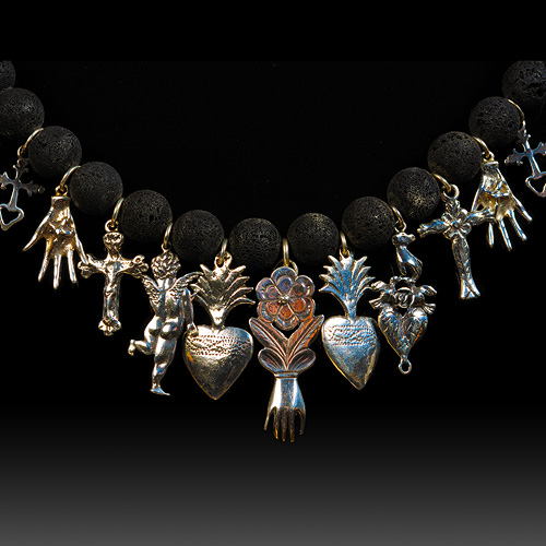 Heart in Hand Necklace by Judtih Moore. Jewelry photography by Steve Rossman