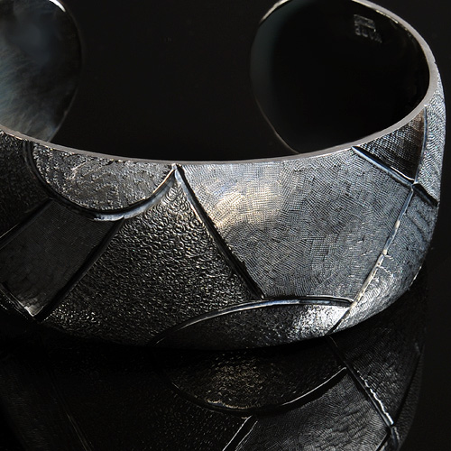 Sterling silver Cuff by Pauline Warg. Image by San Diego jewelry photographer Steve Rossman.