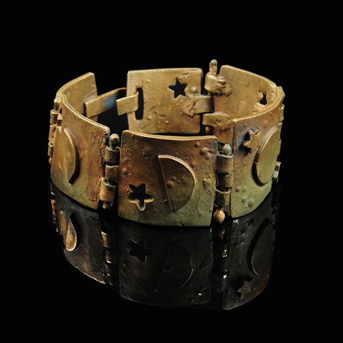 Ancient bronze cuff by Stan Rosier. Jewelry photography by Steve Rossman.