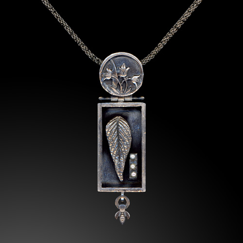 The Naturalist's Cabinet pendant by Jonna Faulkner. Jewelry photography by Steve Rossman.