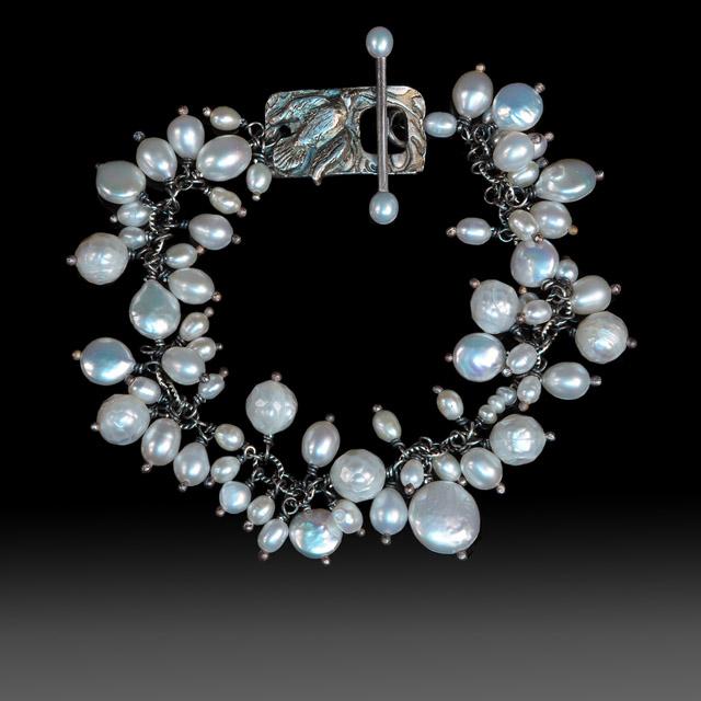 Jonna Faulkner - Bird Toggle bracelet. Jewelry photography by Steve Rossman