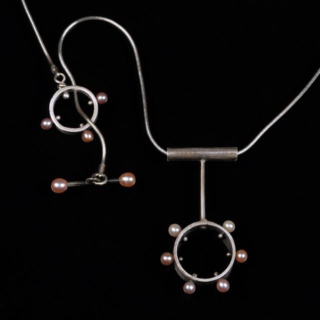 Jonna Faulkner -  Compass Points Necklace. Jewelry Photography by Steve Rossman