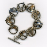 Sheet Metal Bracelet by Dee Harvazinski. Scan by Steve Rossman