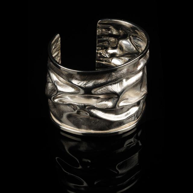 Silver Cuff by Carol Ognibene Kornievsky.  Jewelry Photography by Steve Rossman