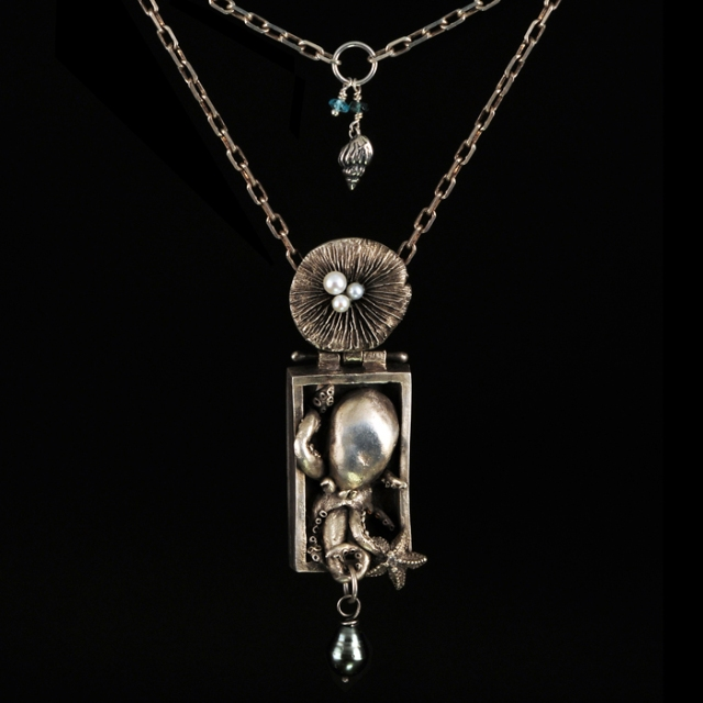 Octopus Treasure by Barbara Whitehill. Jewelry photgraphy by Steve Rossman.