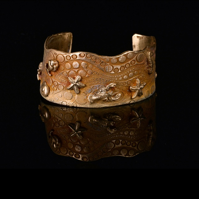By the Sea Goldie Bronze Cuff by Kathy Cook.  Jewelry photography by Steve Rossman