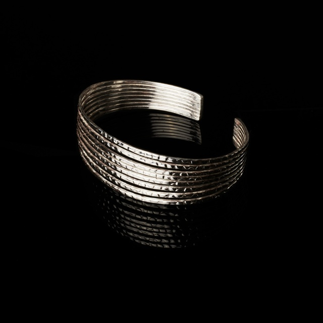 Cecilia Nataly Silver cuff bracelet. Jewelry photography by Steve Rossman