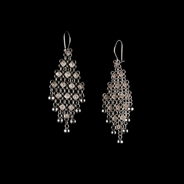 Cecilia Nataly Silver lace earrings. Jewelry photography by Steve Rossman